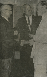 Mr Thomas (left) being presented to the Governor of Queensland, Sir Henry Abel Smith by Ald. G.C. Sykes president of the Gympie R.SL sub branch.