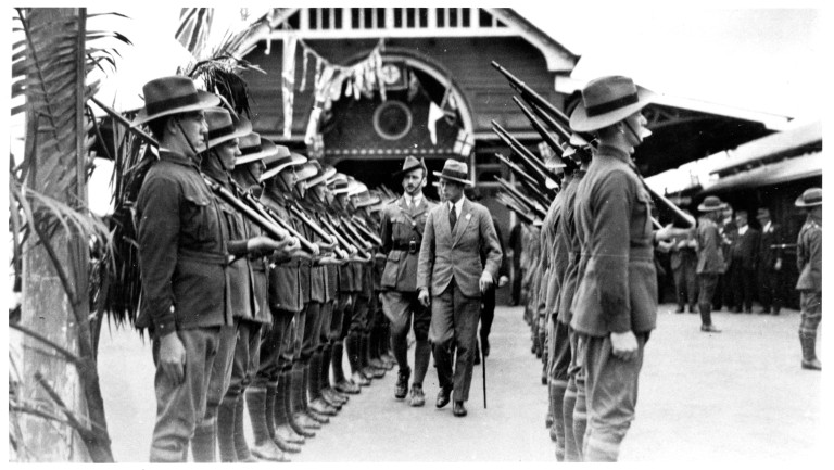 Capt George Thomas behind the Prince of Wales inspecting guard of honour of cadets at station on arrival 3.08.1920